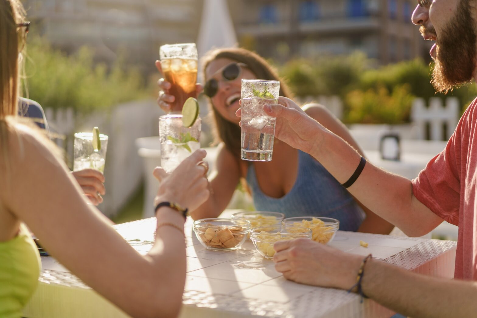 out of focus photo of friends socializing at happy hour cheers with drinks